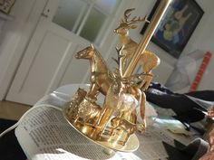 DIY alert! plastic toys + old lamp + gold spray = fantastic new lamp!