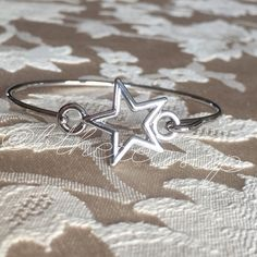 """GORGEOUS SILVER STAR BANGLE BRACELET OBSESSED!! 18K white gold plated open star bangle bracelet. Diameter measures 6.5"""" approx with a 3.2cm approx star. Stacked with your other favorites or alone this bangle is a total attention grabber! @bthereasap Jewelry Bracelets"""