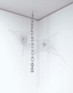 Jim Hodges — I Know This. Steel and silver chain. 1994.