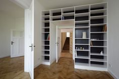 Awsome way to add closets and built-in book case around doorway.