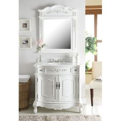 Dimensions: 36 x 21 x This Antique white finish Fairmont Bathroom Vanity has a traditional antique look with ornate molding throughout. Center cabinet doors open to large interior storage. Bathroom Vanity Store, Single Bathroom Vanity, Bathroom Styling, White Bathroom, Small Bathroom, Bathroom Vanities, Bathroom Cabinets, Bathroom Ideas, Blue Bathrooms