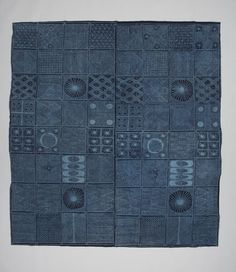 The Yoruba people of Nigeria make indigo resist-dyed cotton cloths called adire, which are worn by women as wraparound dresses. The maker of this cloth cuts a design from a sheet of zinc, lays it on a cloth and applies a starch paste. Several dips in a bath of indigo dye turn the cloth dark blue. When the paste is removed, the covered areas emerge as a lighter pattern against the darker background.