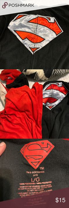 Superman Pajamas Footie pajamas, with Superman logo. Detachable feet and cape! Super warm and cozy. Makes a great costume Intimates & Sleepwear Pajamas Superman Logo, Warm And Cozy, Costumes, Best Deals, Logos, Cape, Jackets, Black, Things To Sell