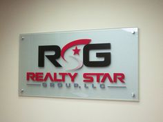 Etched Glass signage with custom PMS painted acrylic letters on tempered glass, mounted with aluminum standoffs on a light beige wall. Glass Signage, Glass Etching, Etched Glass, Acrylic Letters, Glass Printing, Creative Background, Outdoor Signs, Beige Walls, Light Beige