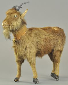 German mohair goat,        Steiff  ???  Might be a button in ear