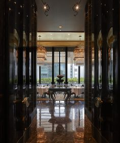 Shàng-Xí restaurant in the Four Seasons Hotel, Shanghai. Its a good example of the level of detail and refinement in their designs and the selection of unusual and luxurious materials.