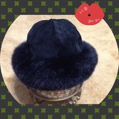Surell fox fur black winter hat Real fur. Fur Origin: Finland Dyed . Hat inside Diameter 13 inches only worn once a bit smaller for me. Bought from off 5th Saks Fifth Aveune. Surell Accessories