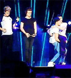 (gif) so here we have Niall playing air guitar Liam holding Zayn wedding style and Harry almost falling over