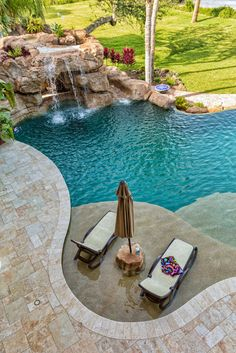 Seen from above, the sub-surface lounge area boasts a built-in stone umbrella stand and table. The stone built grotto feature adds a tropical element.