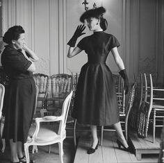 Dior Model Alla in Croque-Mitaine with Seamstress | From a unique collection of black and white photography at http://www.1stdibs.com/art/photography/black-white-photography/