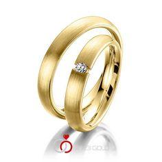 1 Paar Trauringe - Legierung: Gelbgold 585/- Breite: 3,50 - Höhe: 1,80 - Steinbesatz: 1 Brillant 0,05 ct. w, si (Ring 1 mit Steinbesatz, Ring 2 Trauringe Steinbesatz)