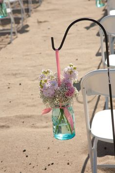 Use Shepherds hooks to hang your pails, jars, leis or flower balls from to decorate your beach wedding ceremony!