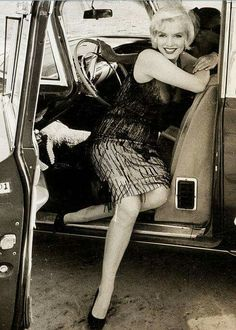 Marilyn Monroe Posing in an automobile