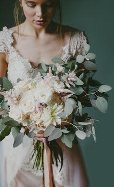 Romantic ivory, blush, and green spring bridal bouquet | Image by Paula O'Hara Photography