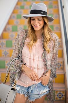Julia Engel is wearing a kimono from Kite & Butterfly, pink top from Isabel Marant, shorts from One Teaspoonhat from Maison Michel and a Cha...