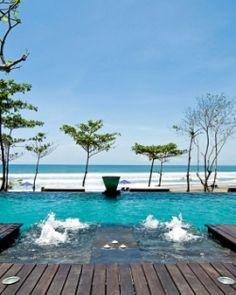 Anantara Seminyak Resort & Spa  ( Bali, Indonesia )  Ocean-facing loungers are hot property at the always-buzzing infinity pool. #Jetsetter