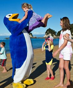 Kori at the launch of a save the penguin initiative in Nelson. Save The Penguin, March Of The Penguins, Penguin Parade, Swim School, Programming For Kids, Product Launch, Swimming, Swim, Kids Programs