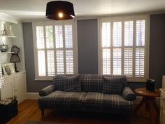 This beautiful living room fitted with tire on tire shutters