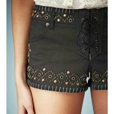 """Kate Moss Topshop studded, sequin, lace up shorts Dark brown shorts with bronze looking studs and sequins.... little zipper underneath the laced up front... waist measures approximately 30"""" & approx. 8 &1/2"""" from the waistband to the hem...cotton/elastane mix....size eur36 - US 4 - uk8 Topshop Shorts"""