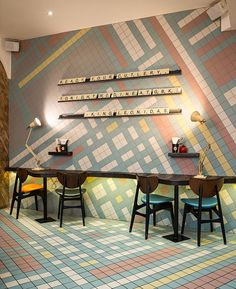 (Counter table) Colourful and abstract use of tiles from the Program range at Gourmet Burger Kitchen.