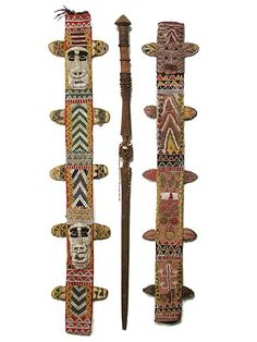 Yoruba Beaded Sheaths | Nigeria  |These sacred beaded sheaths (shown here with an Oko iron staff were used to house such a staff when it was not in ceremonial use. Backed with Ashoke cloth, both of these sheaths show the intricate beadwork and small glass beads found in older pieces of Yoruba beadwork.