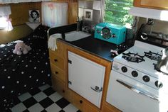 Interior of the black and white camper. Cute as a button!