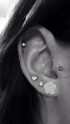 Tragus, double cartilage and triple lobe piercing. Ear piercings