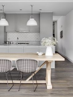 Pale Gray grey cabinets and wood floors with white subway tile backsplash