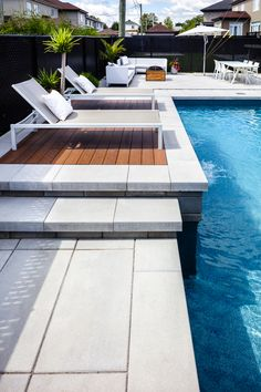 Poolside inspiration.  Contemporary landscape ideas for patios, pools and backyards. Outdoor water fountains and poolside waterfalls.