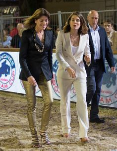 Princess Caroline of Monaco with her daughter Charlotte Casiraghi. Love Caroline's look-- the blazer with the tight pants and those shoes are fabulous! Shows that a woman in her mid-life years can still look very fashionable without appearing to look desperate.
