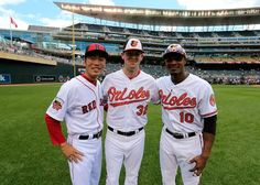 American League All-Stars Koji Uehara #19 of the Boston Red Sox and Matt Wieters #32 and Adam Jones #10 of the Baltimore Orioles pose for a photo prior to the 85th MLB All-Star Game at Target Field on July 15, 2014 in Minneapolis, Minnesota.