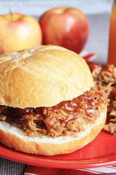 Pork roast slow cooks in apple cider and cider vinegar, and then shredded and combined with yummy BBQ sauce - a perfect and fun meal for a crowd this fall!