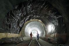 2010.10.05 - Men stood in the Erstfeld-Amsteg section of the Gotthard Base Tunnel in Switzerland Tuesday. The train tunnel, which will be the longest such tunnel, is expected to open by the end of 2017 when construction is completed. (Arnd Wiegmann/Reuters)