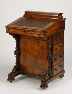 "19th century English burlwood ship captain's desk with inset leather top surmounted by a lidded compartment to hold pens, the top lifting to reveal added storage, with four drawers on the side, 32.5""h x 21""w x 21""d."