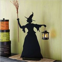 witches hat decoration this hat is made using a foam cone as a base for paper or fabric modge podge helps with the shaping decorate as desired
