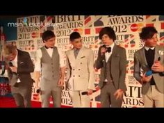 One Direction after they got the Brits.  soooooo hot! <3 Pretty sure they are oober drunk in this. Idk what they are talking about....