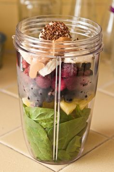 Spinach, Pineapple, Frozen Blueberries, Frozen Raspberries, Banana, Flaxseeds, 1 tsp. Cashew Butter, Add water & Blend.