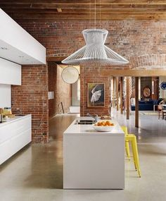 High ceilings , exposed brick