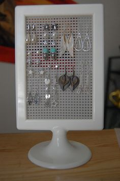 DIY Jewelry Organizing Roundup! .99 cent frames from Ikea with plastic canvases for cross stitch.