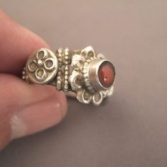 A splendid old ring (early 20th c) from Tibet in silver and set with a nice bead of coral ... here the interesting aspect is the sophistication of the work of the body of the ring with floral motives ...Weight : 8,3gr Size : 55 adaptable Dating from early 20th century ... To be sale in my shop at 28, Galerie du Roi at 1000 Brussels ... and next week at Antica Namur exhibition from the 14 till the 22 of november at my stand G26