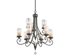 The Lara™ collection from Kichler allows you to add the allure of candles to any room, yet you can turn them on with the flip of a switch. At first glance you will notice the delicate scrollwork on this 9 light chandelier, but look closer and you'll see how clear shades actually surround beautifully detailed glass candle replicas. Crystal accents and a Shadow Bronze™ finish add even more sophistication to this timeless style.