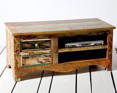 The handmade Riya 2 drawer TV cabinet / plasma cabinet stylishly combines the history and character of reclaimed wood with a contemporary look which will beautifully complement your living room technology.