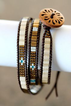 triple leather beaded wrap bracelet bronze and cream by girlthree Wickelarmband aus dreifachem Leder mit Perlen in Bronze und Creme von girlthree Diy Schmuck, Schmuck Design, Beaded Wrap Bracelets, Beaded Jewelry, Crochet Bracelet, Gold Necklaces, Hippie Jewelry, Diamond Bracelets, Pandora Bracelets