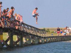 Jumping off the Sandwich Boardwalk. A right of passage for Sandwich children.