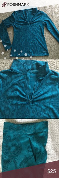 Eddie Bauer Athletic Top Gorgeous teal colored long-sleeved athletic top by Eddie Bauer.  ▪️Thumb holes ▪️Never been worn  🚭 Smoke-free home 📬 Ships by next day 💲 Price negotiable    💟Happy Poshing!💟 Eddie Bauer Tops Tees - Long Sleeve