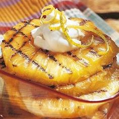 Grilled Pineapple-This one looks good but I have an easier one that doesn't need a grill. I melt a couple of tablespoons of butter in a nonstick skillet and sauté 1/2 inch slices of fresh pineapple on medium high heat. Sprinkle them generously with cinnamon sugar. Turn and sprinkle the other side. Continue sautéing until they are golden brown, taking care that they do not burn. These are so good.