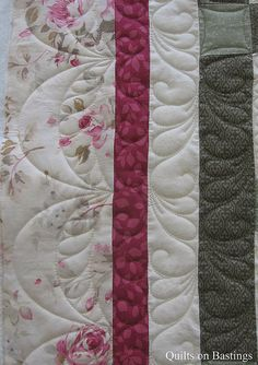 Sampler Quilt by QOB, via Flickr--like the border quiltings
