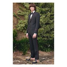 Part of the #GucciCruise17 Men's collection, black 70s style tuxedo with silk bow tie worn with a pair of Gucci Princetown slippers featuring an embroidered tiger appliqué. Photographer: @nickwaplington