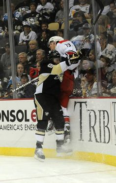 See ya Bellemore !! There's more free candy where that came from.. Pascal Dupuis checks a Hurricane hard against the boards during the game 10/8/13