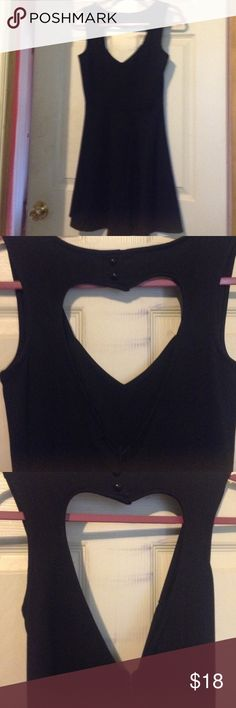 Heart Cutout Skater Dress skater style • heart cutout on back • v-cut • sleeveless • worn once • like new Miss Chievous Dresses